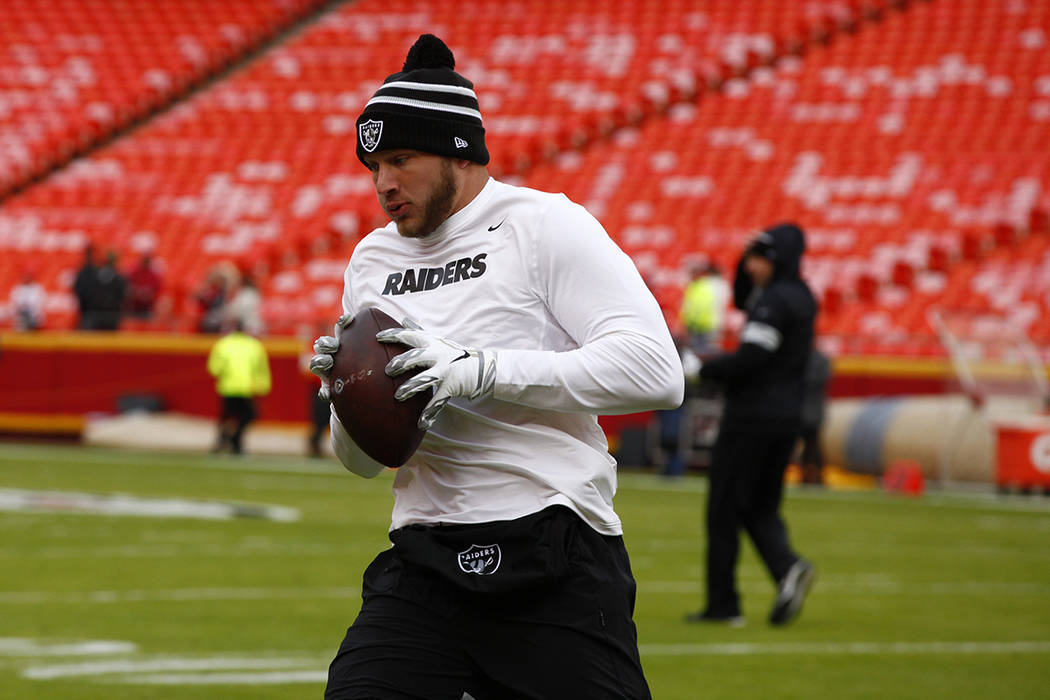 Oakland Raiders tight end Foster Moreau catches the football during pregame warmups before an N ...