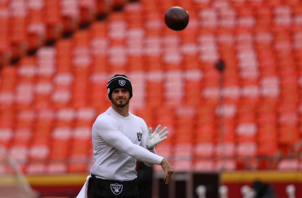 Oakland Raiders quarterback Derek Carr throws the football during pregame warm ups prior to an ...