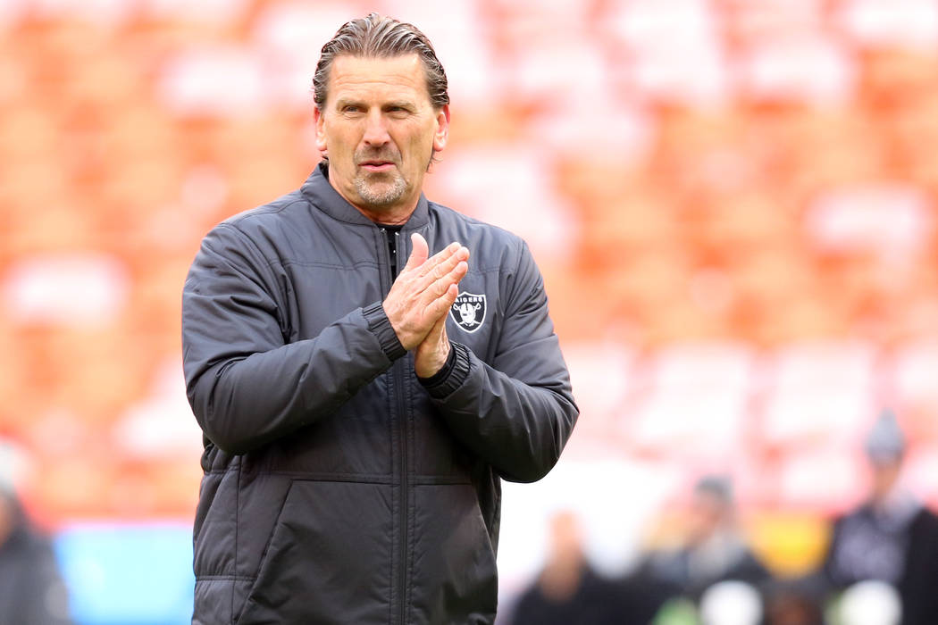 Oakland Raiders offensive coordinator Greg Olson rubs his hands together prior to an NFL game a ...