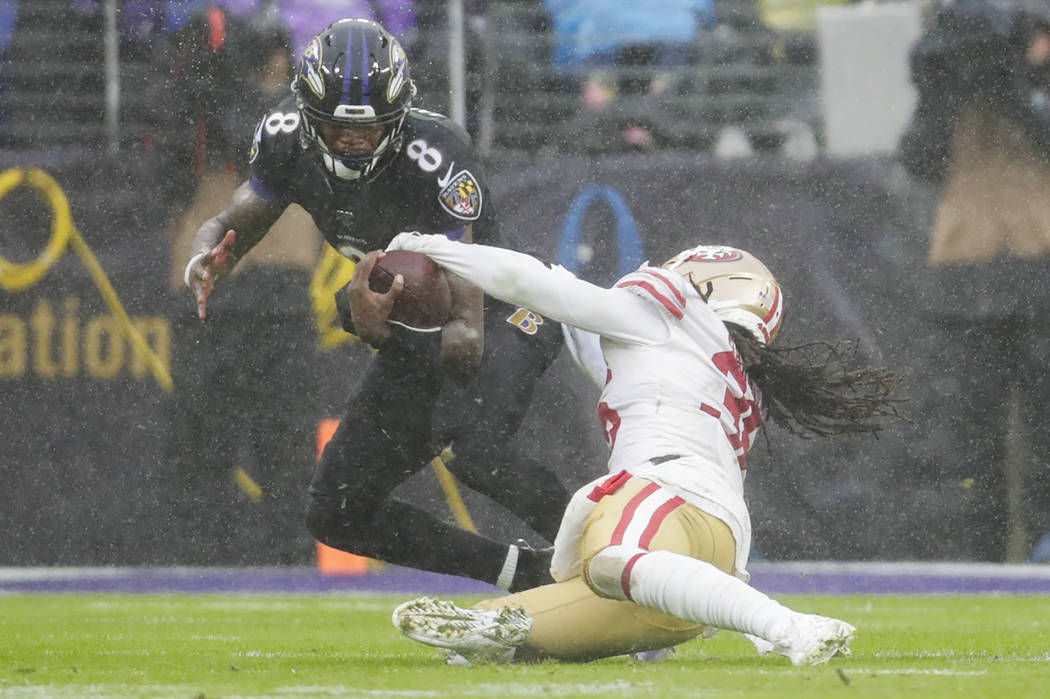 San Francisco 49ers defensive back Marcell Harris (36) strips the ball from Baltimore Ravens qu ...