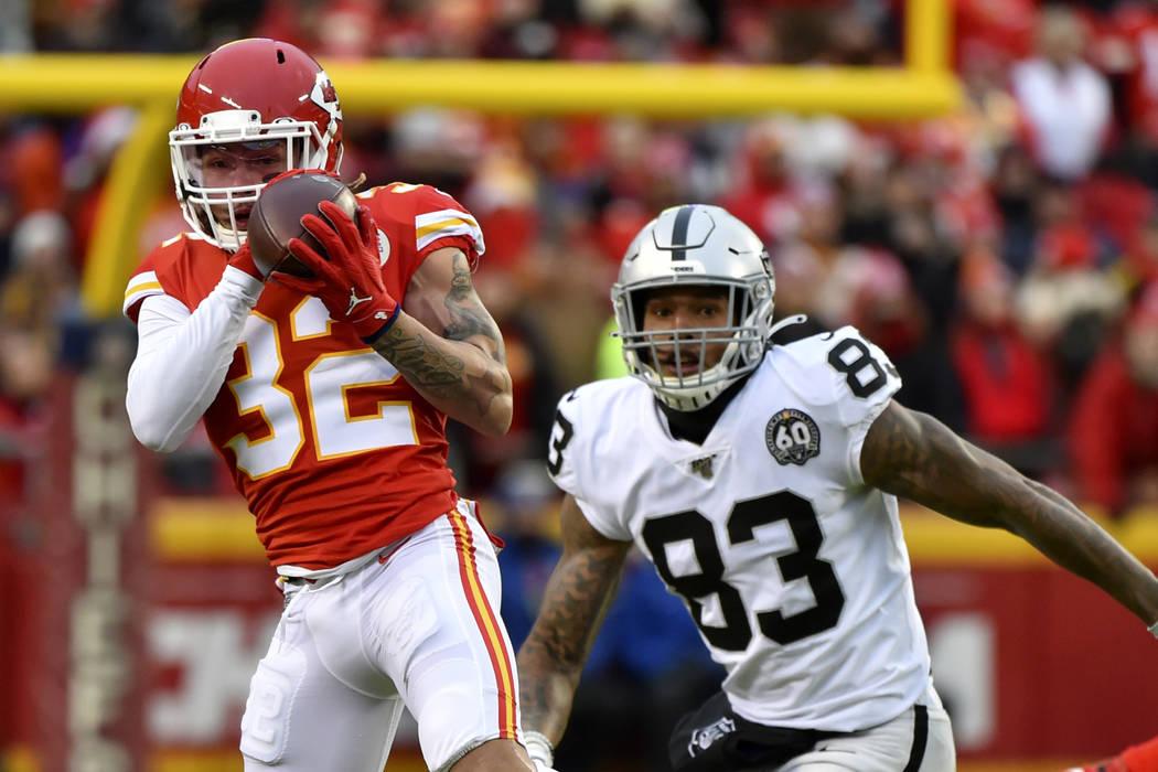 Kansas City Chiefs safety Tyrann Mathieu (32) intercepts a pass intended for Oakland Raiders ti ...