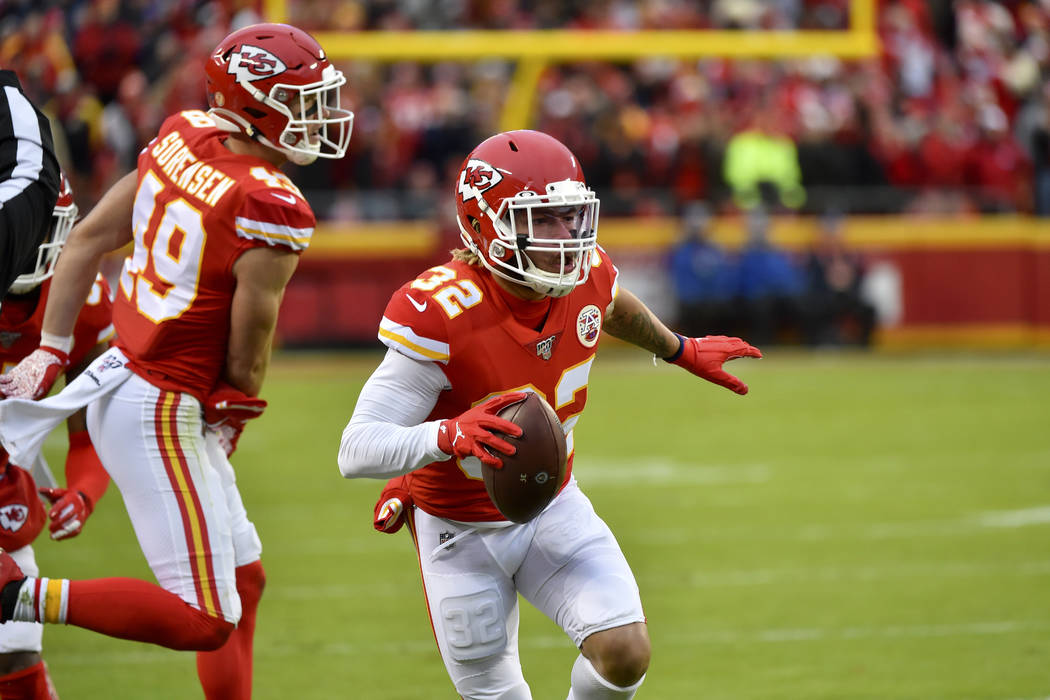 Kansas City Chiefs safety Tyrann Mathieu (32) carries the ball after an interception against th ...