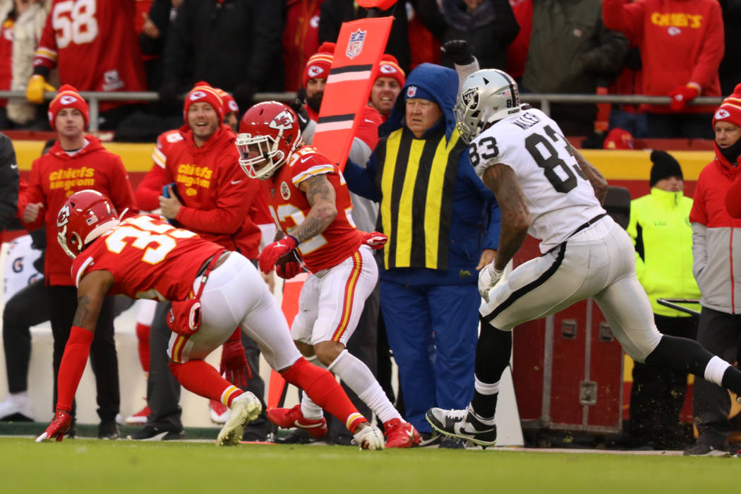 Kansas City Chiefs strong safety Tyrann Mathieu (32) follows cornerback Charvarius Ward (35) do ...