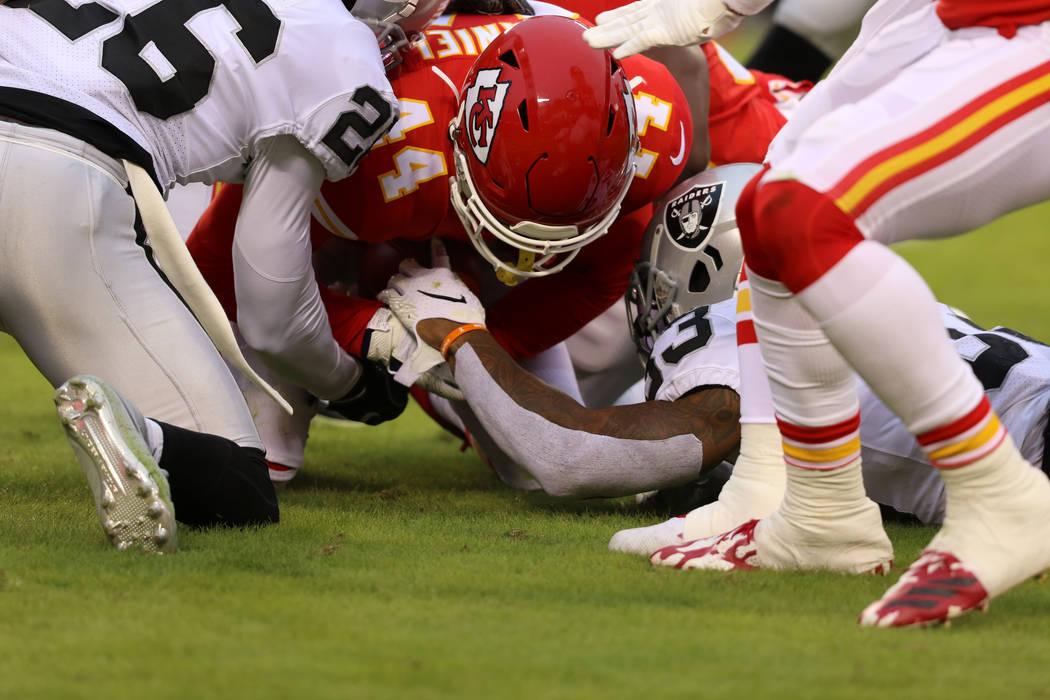 Kansas City Chiefs linebacker Dorian O'Daniel (44) recovers a fumble as Oakland Raiders running ...
