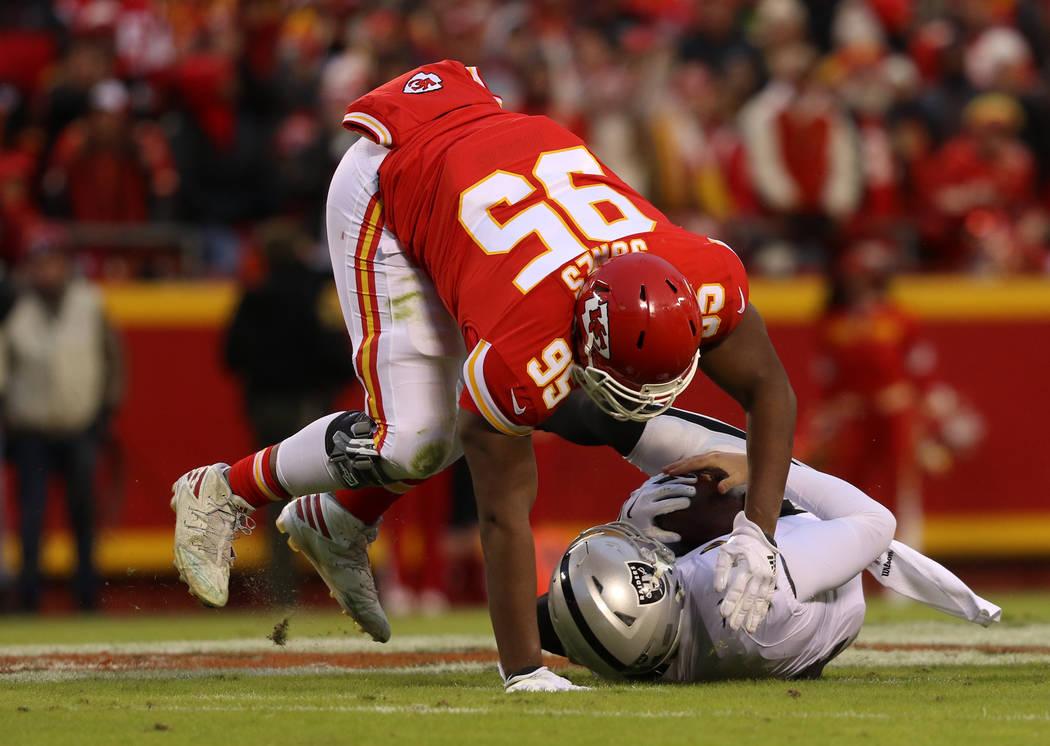 Kansas City Chiefs defensive end Chris Jones (95) sacks Oakland Raiders quarterback Derek Carr ...