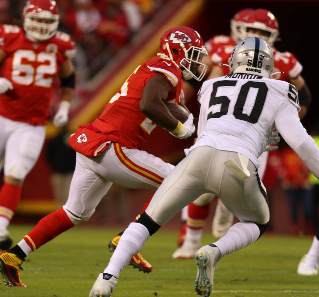 Kansas City Chiefs running back LeSean McCoy (25) rushes with the football as Oakland Raiders l ...