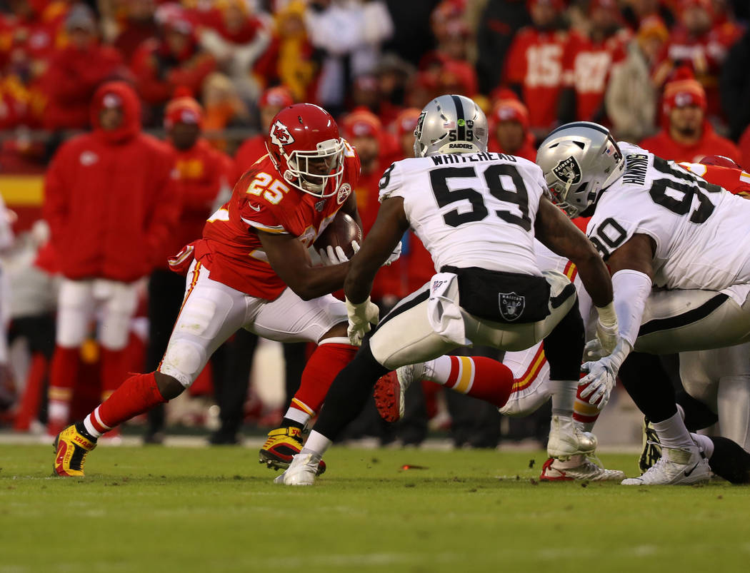 Kansas City Chiefs running back LeSean McCoy (25) rushes with the football as Oakland Raiders o ...