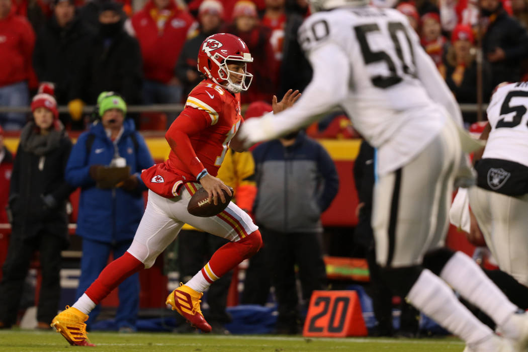 Kansas City Chiefs quarterback Patrick Mahomes (15) runs for the end zone during the first half ...