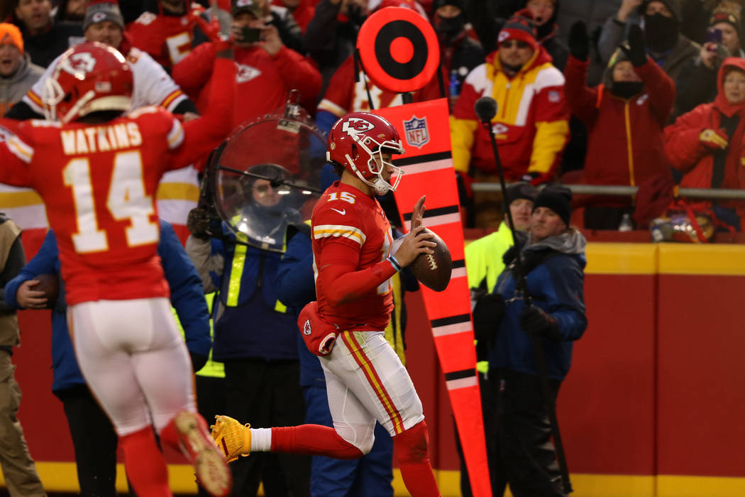 Kansas City Chiefs quarterback Patrick Mahomes (15) rushes into the end zone and scores a touch ...