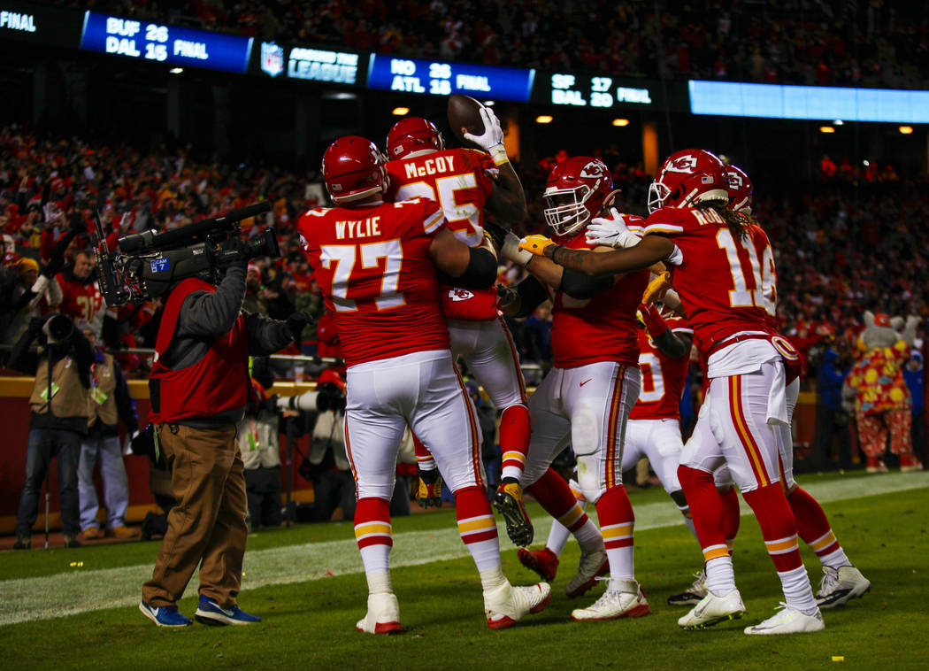 Kansas City Chiefs running back LeSean McCoy (25) is lifted up by offensive guard Andrew Wylie ...
