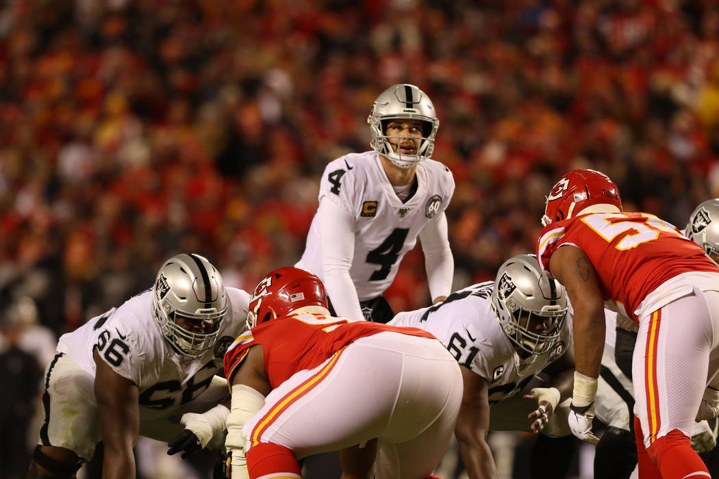 Oakland Raiders quarterback Derek Carr (4) looks up before hiking the football during the secon ...