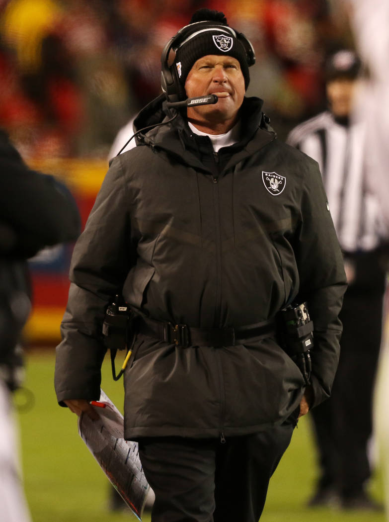 Oakland Raiders head coach Jon Gruden walks the sideline during the second half of an NFL game ...