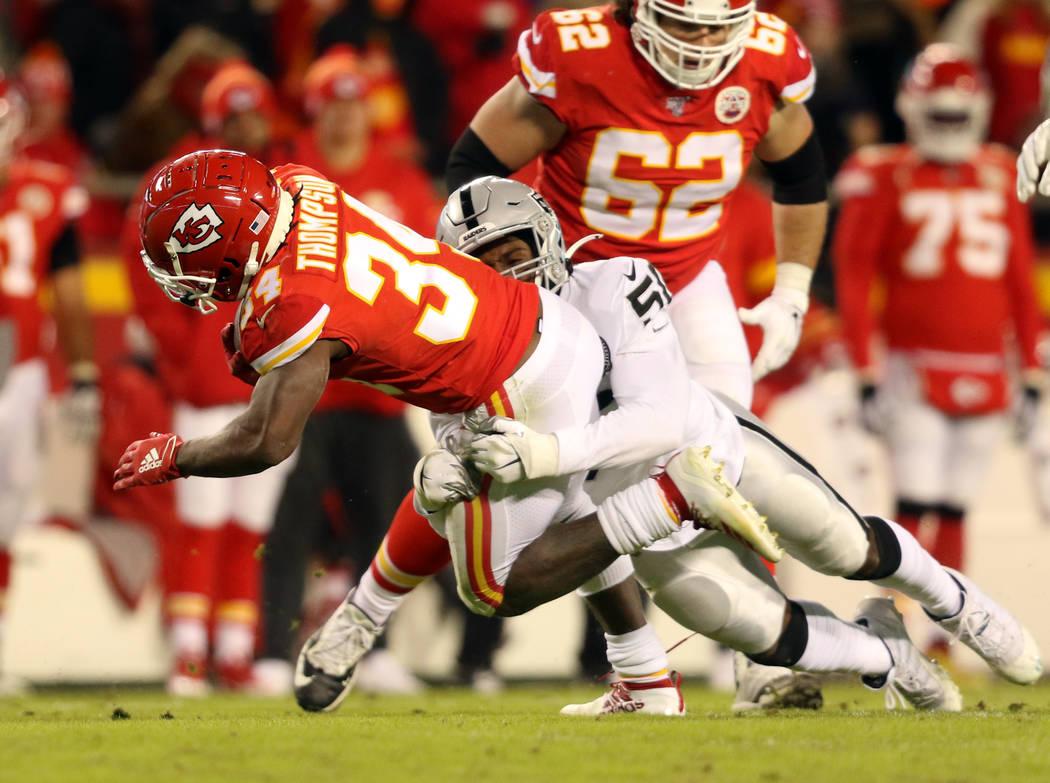 Oakland Raiders linebacker Nicholas Morrow (50) tackles Kansas City Chiefs running back Darwin ...