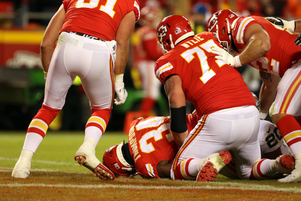 Kansas City Chiefs running back Darwin Thompson (34) scores a touchdown during the second half ...