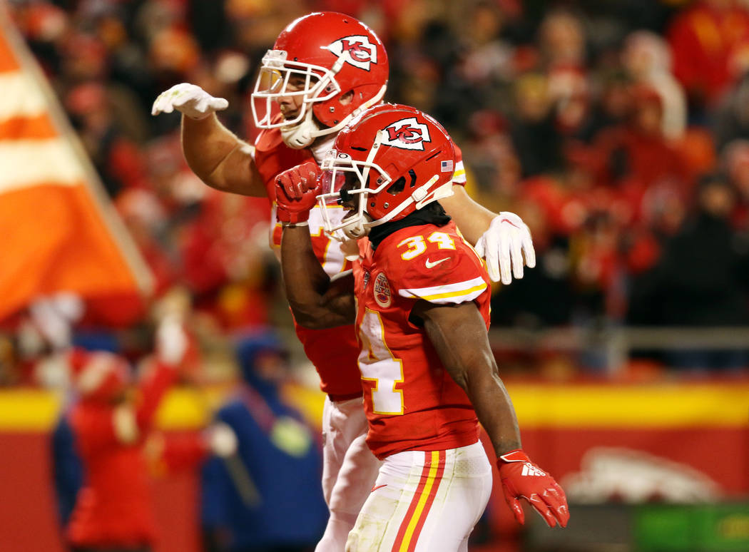 Kansas City Chiefs running back Darwin Thompson (34) celebrates his touchdown with tight end Tr ...