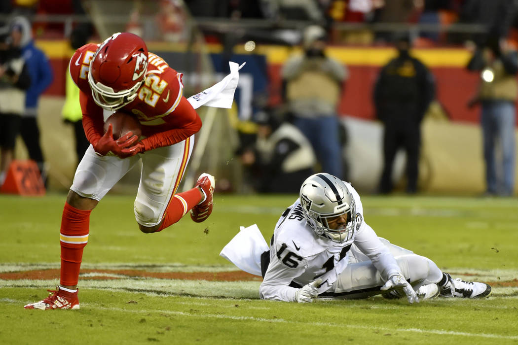 Kansas City Chiefs safety Juan Thornhill (22) intercepts a pass intended for Oakland Raiders wi ...