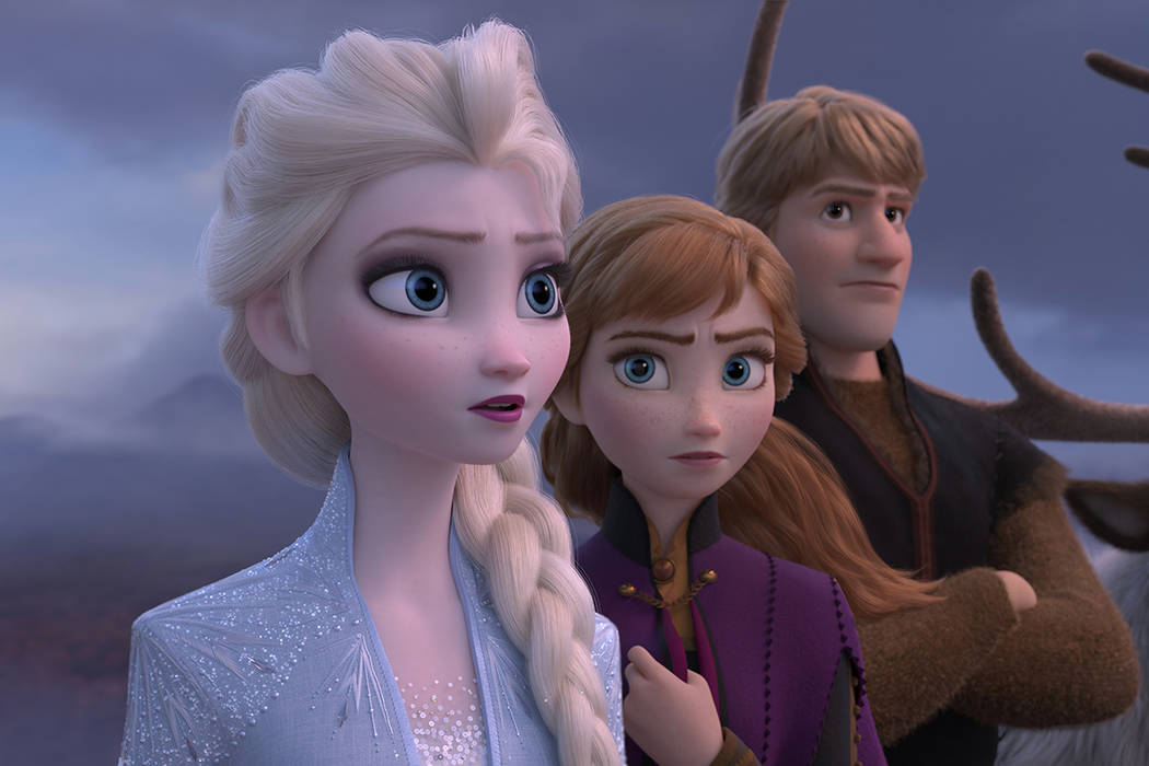 This image released by Disney shows Elsa, voiced by Idina Menzel, from left, Anna, voiced by Kr ...