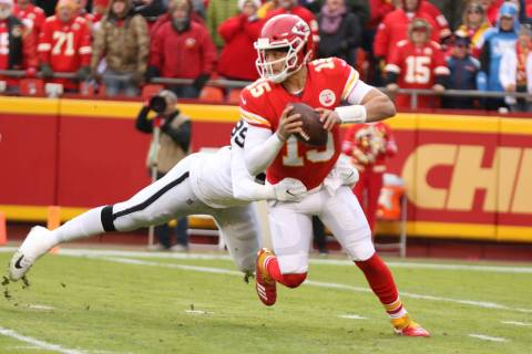 Kansas City Chiefs quarterback Patrick Mahomes (15) sheds a tackle by Oakland Raiders defensive ...