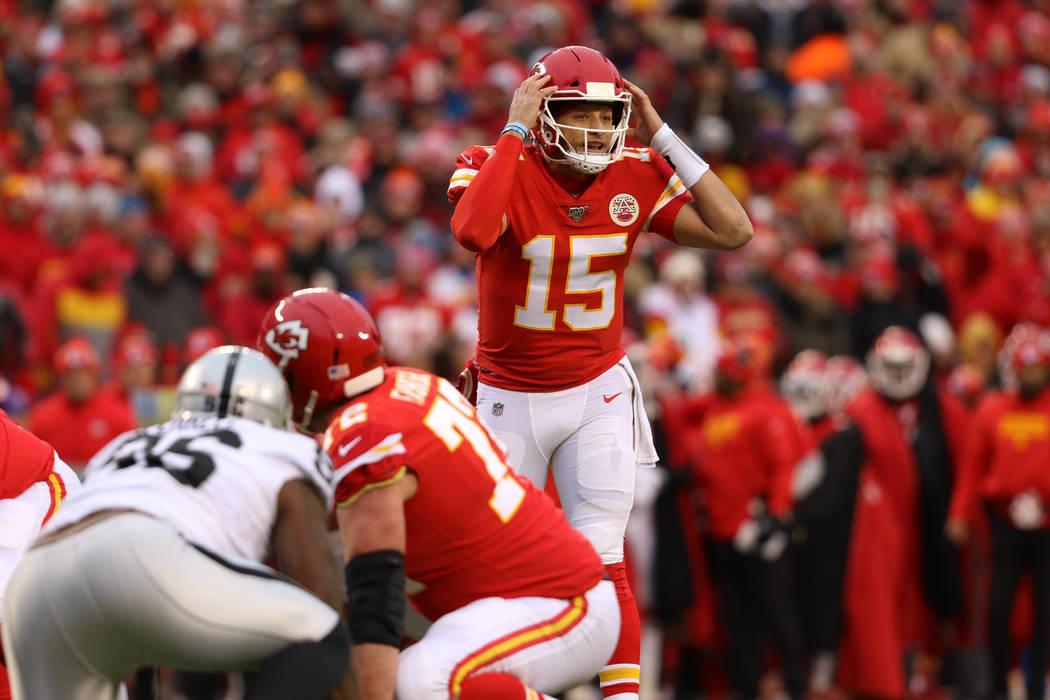 Kansas City Chiefs quarterback Patrick Mahomes (15) calls a play at the line of scrimmage durin ...