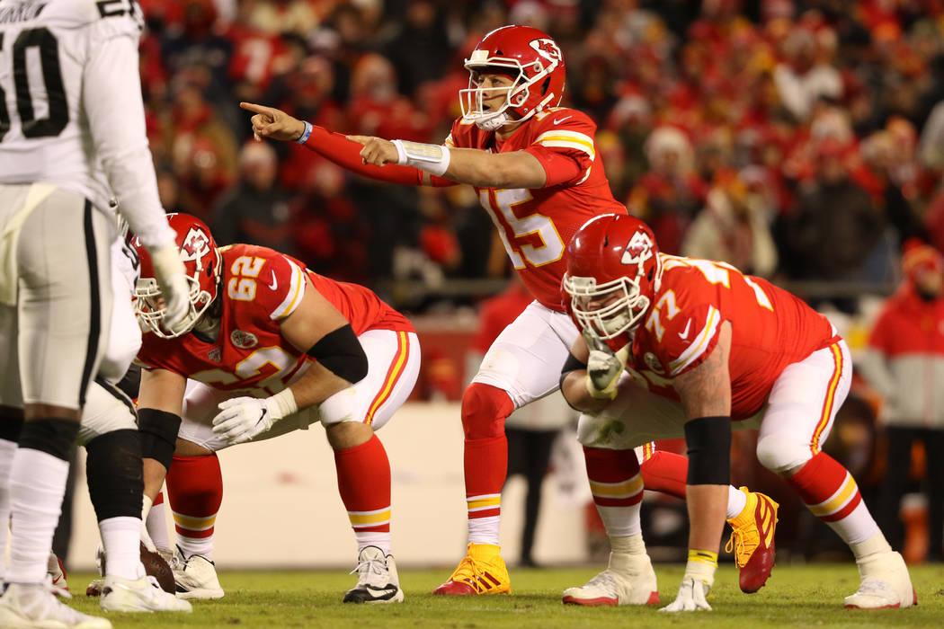 Kansas City Chiefs quarterback Patrick Mahomes (15) calls an audible at the line of scrimmage d ...