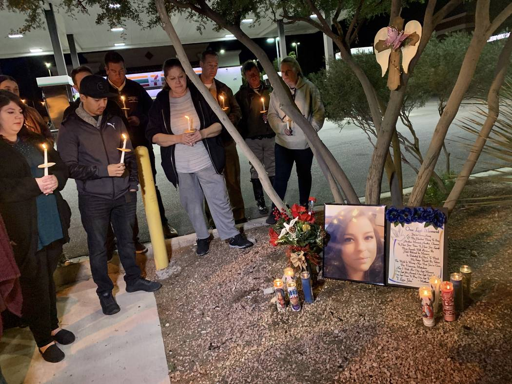 Friends and family gathered outside of a 7-Eleven in southwest Las Vegas on Sunday evening to h ...
