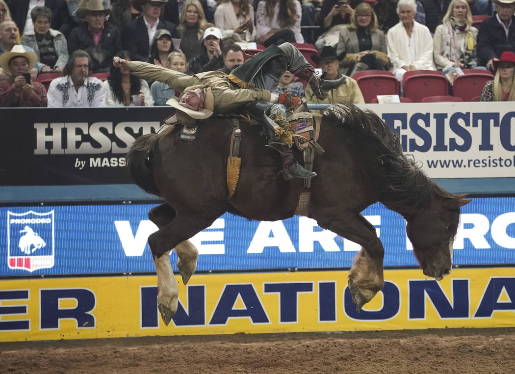 Will Lowe of Canyon, Texas (120) competes in the bareback riding event during the eighth go-rou ...