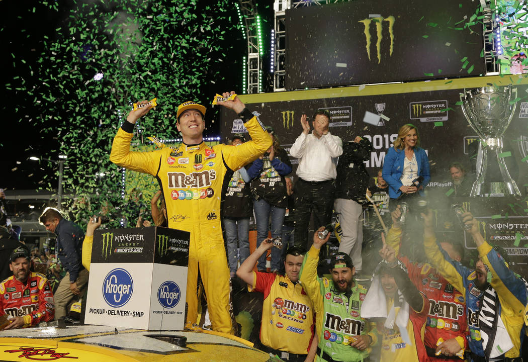 Kyle Busch celebrates in Victory Lane after winning the NASCAR Cup Series auto racing season ch ...