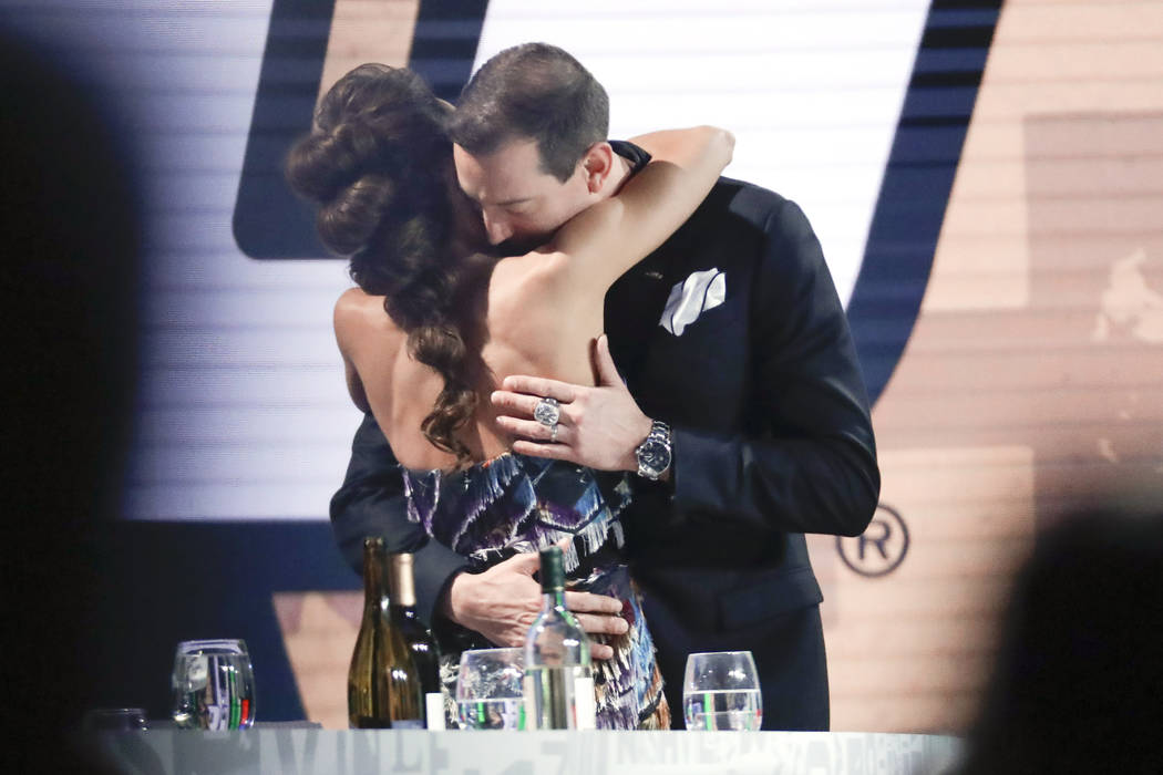 Kyle Busch is hugged by his wife, Samantha, after Busch was honored as the season's champion at ...