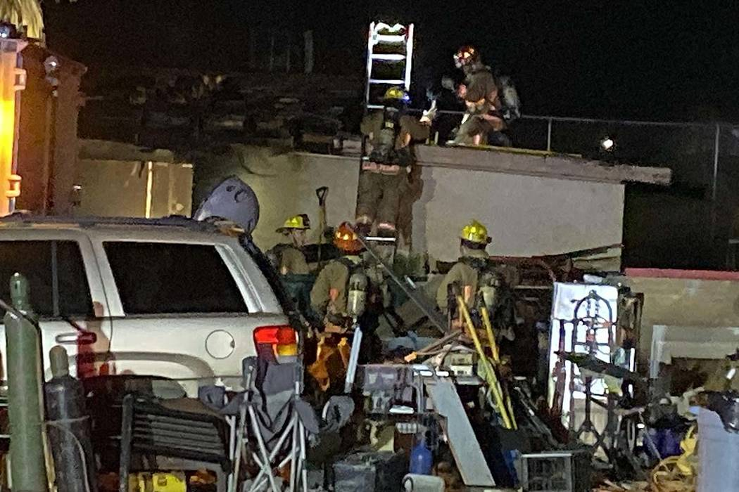 Fire crews work on a fire in a guest house near North Campbell and West Lone Mountain roads on ...
