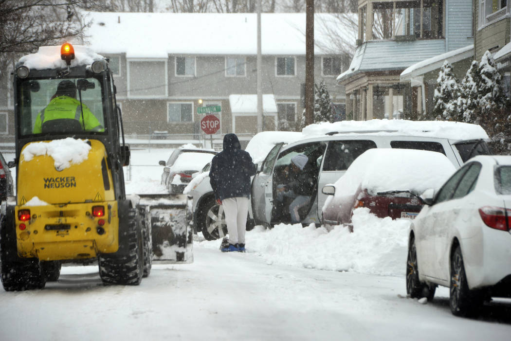 A vehicle is stuck in the snow on Murray Hill Avenue in Springfield's Liberty Heights neighborh ...
