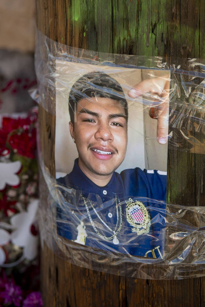 A photograph is hung at a memorial site for Kevin Soriano, 17, of North Las Vegas, who was shot ...