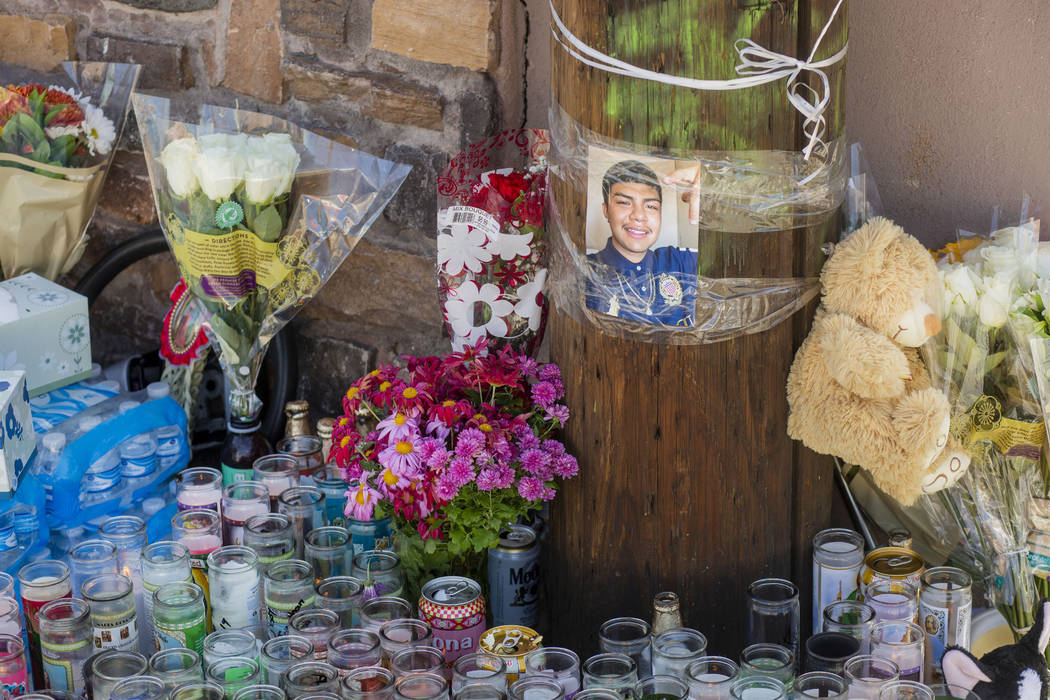 Candles burn at a memorial for Kevin Soriano, 17, of North Las Vegas, who was shot and killed S ...