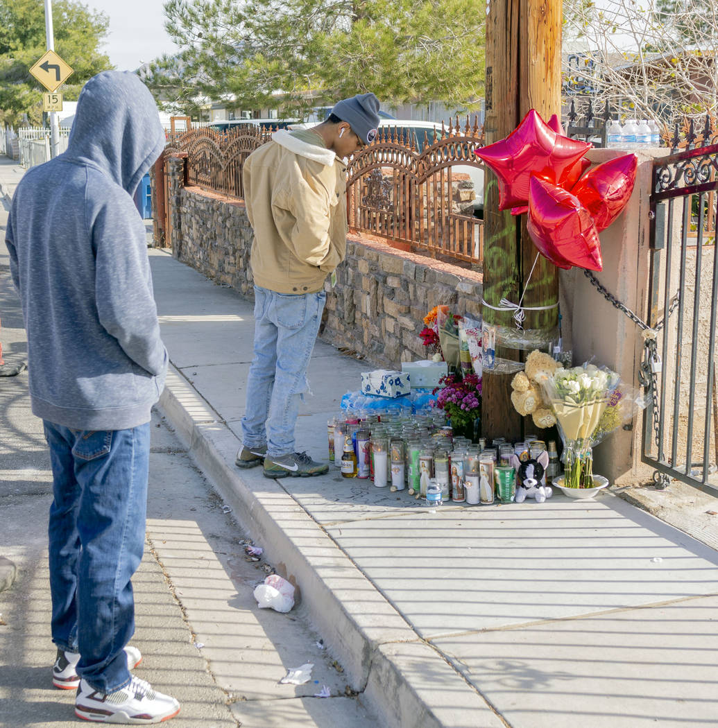 David Lopez, 18, North Las Vegas, left, and Juan Dizzle, 18, visit the memorial for Kevin Soria ...