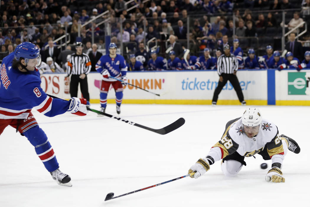 Vegas Golden Knights left wing William Carrier (28) blocks a shot by New York Rangers defensema ...