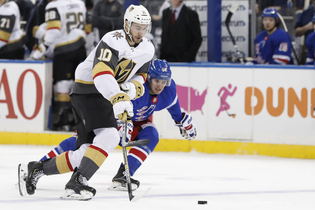 New York Rangers left wing Pavel Buchnevich (89) tries to keep up with Vegas Golden Knights cen ...