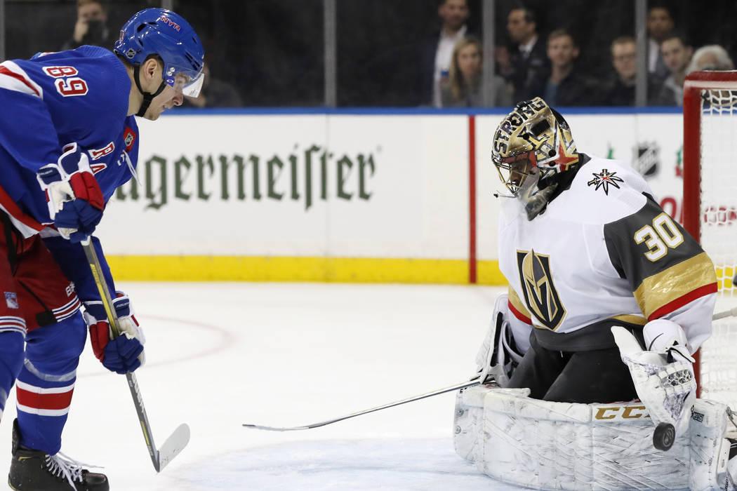 Vegas Golden Knights goaltender Malcolm Subban (30) blocks a shot by New York Rangers left wing ...