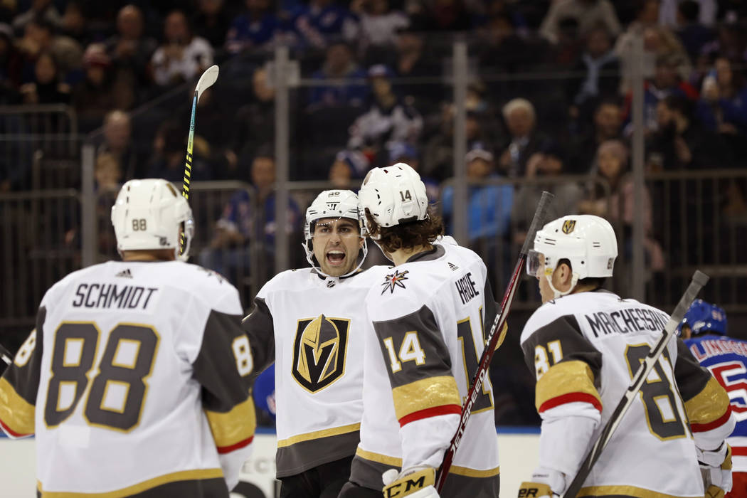 Vegas Golden Knights right wing Alex Tuch, second from left, reacts with teammates after scorin ...