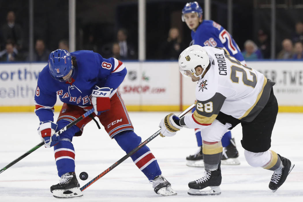 New York Rangers defenseman Jacob Trouba (8) searches for the puck as Vegas Golden Knights left ...