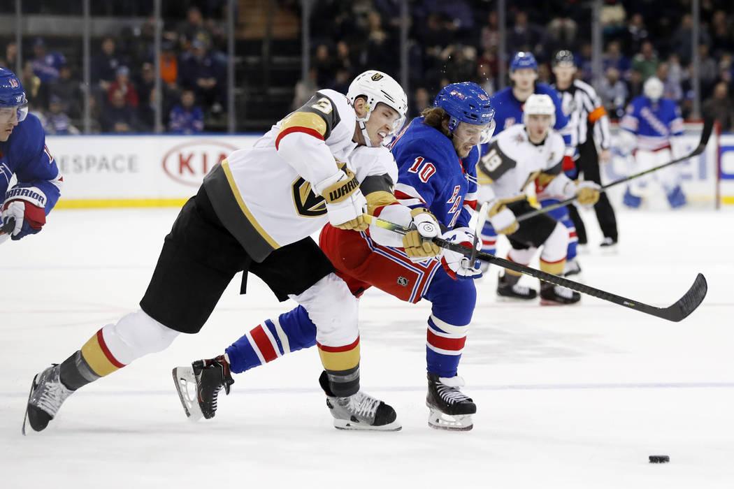 Vegas Golden Knights defenseman Brayden McNabb (3) and New York Rangers center Artemi Panarin ( ...