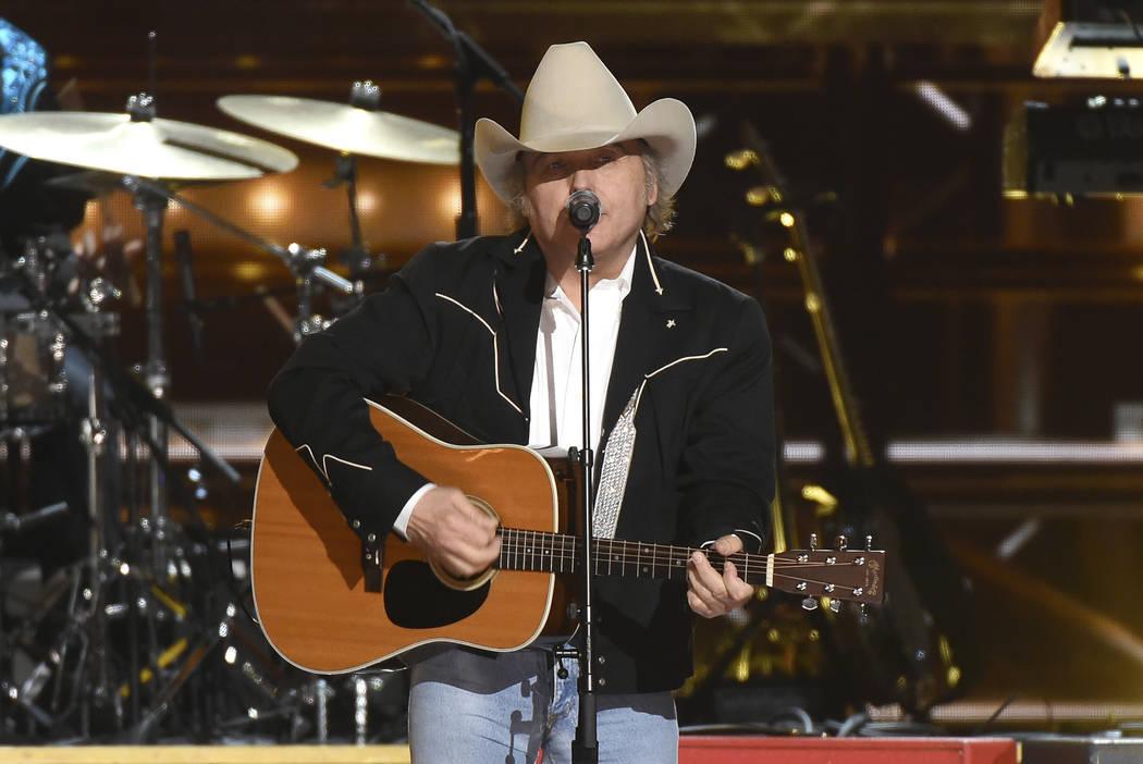 """Dwight Yoakam performs """"Guitars, Cadillacs"""" at the 50th annual CMA Awards at the Brid ..."""