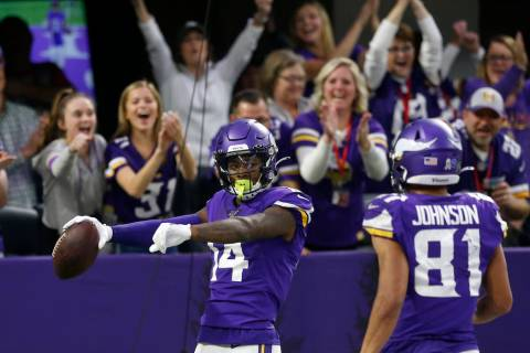 Minnesota Vikings wide receiver Stefon Diggs (14) celebrates with teammate Bisi Johnson, right, ...