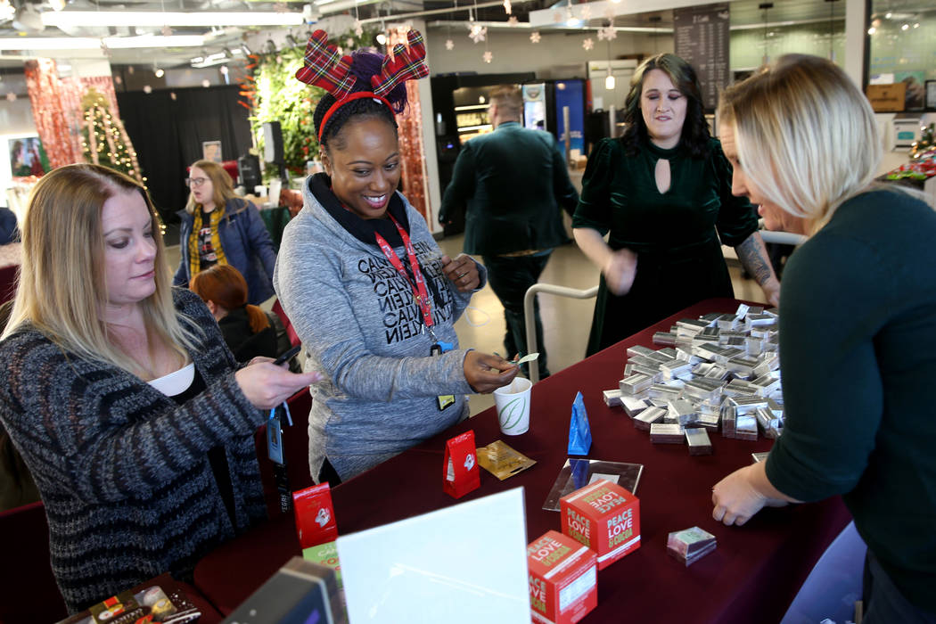 Zappos Fungineers Audrea Hooper, right, and Roni Roberts, second from right, help Nicole Morgan ...