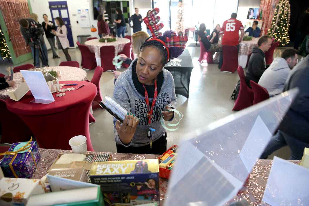 """Zappos team member DeShawn Alcazar picks out a free """"finer things"""" gift at the compan ..."""