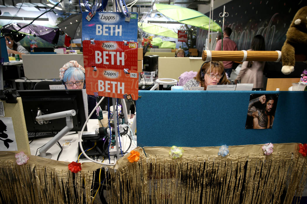 Zappos Customer Loyalty Team members, including Beth Mergenthal, left, and Terry Domingo work t ...