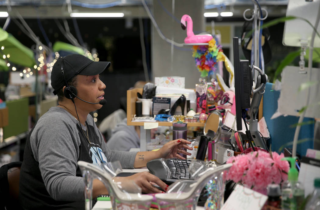 Zappos Customer Loyalty Team members, including Sanja Smith, work the phones at the company's h ...