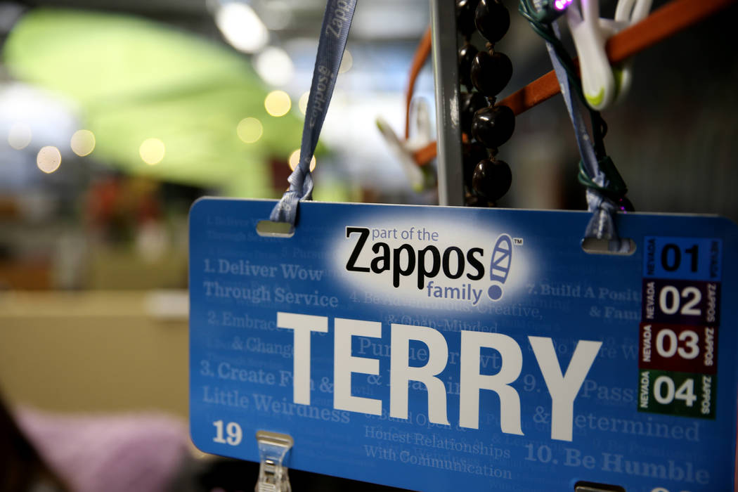 A placard for Zappos Customer Loyalty Team member Terry Domingo at her desk at the company's he ...