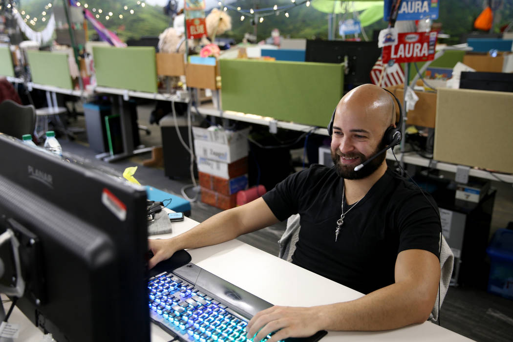 Zappos Customer Loyalty Team members, including Justin Shiloh, work the phones at the company's ...