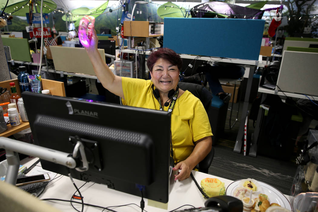 Zappos Customer Loyalty Team members, including Margret Hosmer-Colen, work the phones at the co ...
