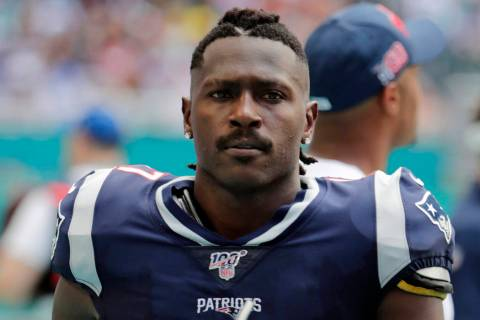 Then New England Patriots wide receiver Antonio Brown (17) on the sidelines,during the first ha ...