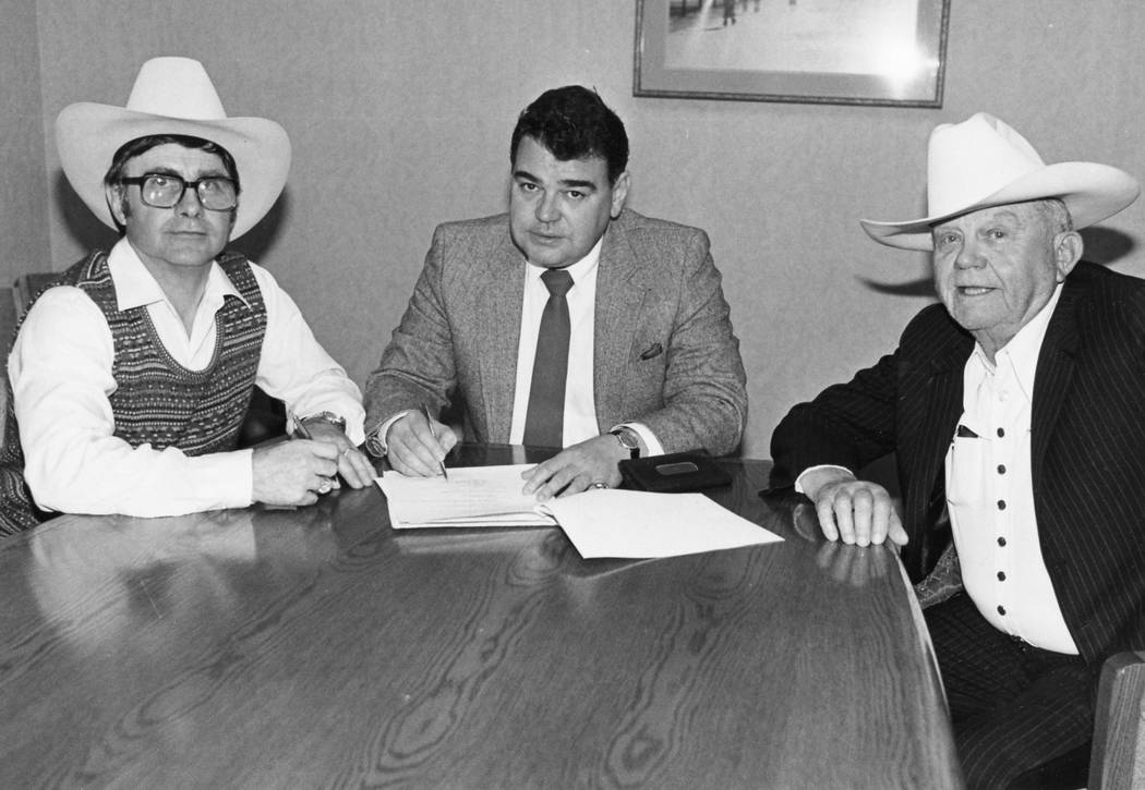 Shawn Davis, shown here (at left) with Phil Arce and Benny Binion, executes the agreement to br ...